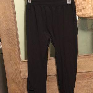 Pants - Criss cross open leg leggings new with tags